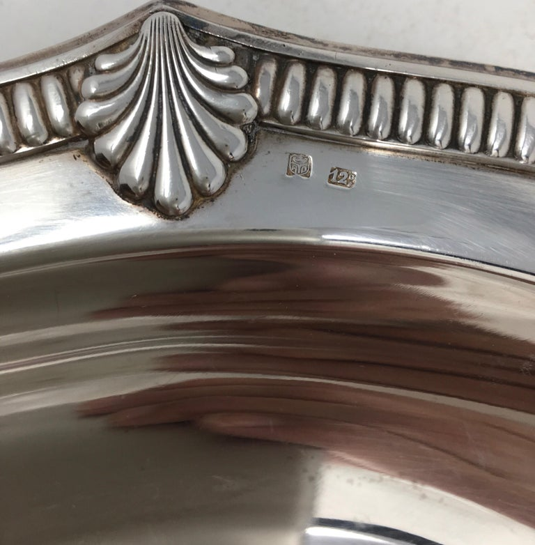 Found in France, this vintage hotel silver serving platter with beautifully detailed edge, has a great aged patina. It would be wonderful in a cabinet and a great addition to your table or buffet.