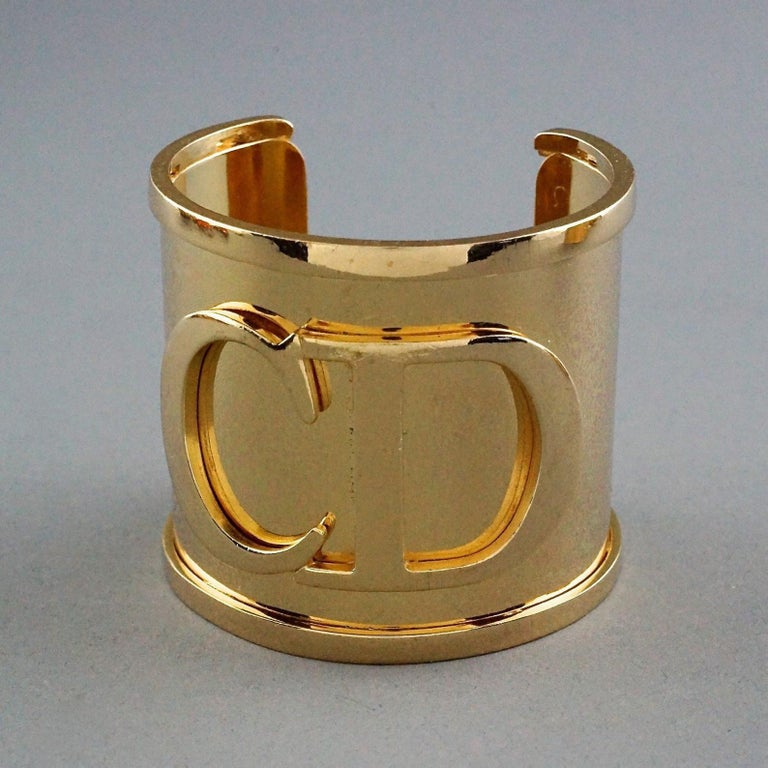 Vintage Iconic CHRISTIAN DIOR CD Logo Initials Wide Cuff Bracelet  Measurements: Height: 2.20 inches (5.6 cm) Total Circumference: 6.81 inches (17.3 cm) including the opening Opening: 1.37 inches (3.5 cm)  Features: - 100% Authentic CHRISTIAN