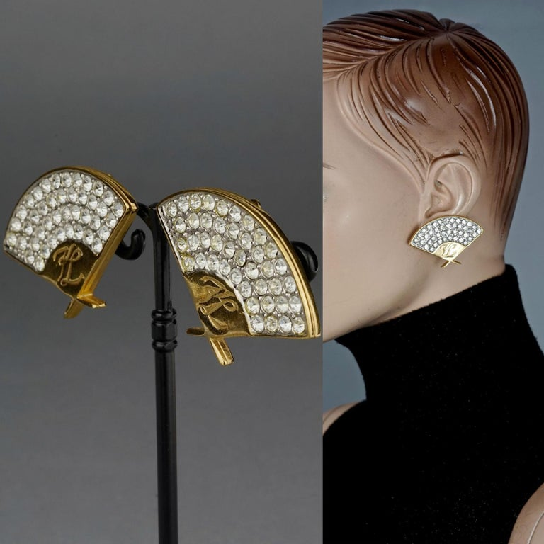 Vintage Iconic KARL LAGERFELD Logo Fan Rhinestone Earrings  Measurements: Height: 1.25 inches (3.2 cm) Width: 1.85 inches (4.7 cm) Weight per Earring: 15 grams  Features: - 100% Authentic KARL LAGERFELD. - Iconic Lagerfeld fan earrings with engraved