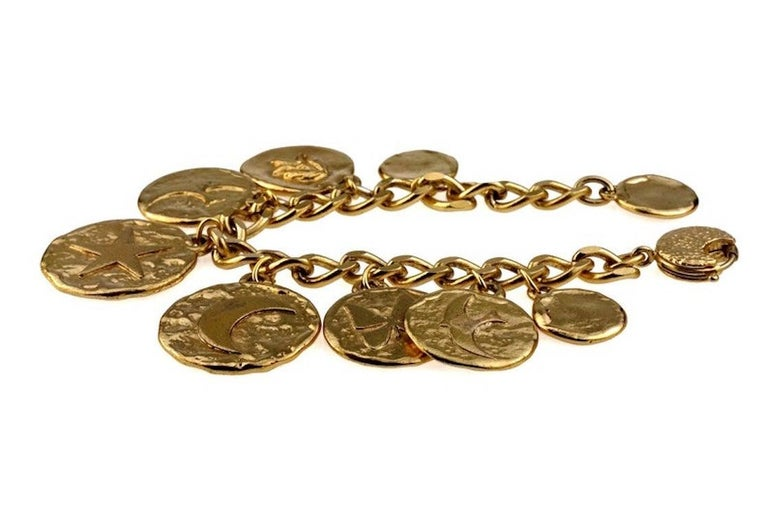 Vintage Iconic YVES SAINT LAURENT Ysl Emblem Medallion Charm Bracelet  Measurements: Height: 1.65 inches (4.2 cm) Wearable Length: 8.46 inches (21.5 cm) maximum  Features: - 100% Authentic YVES SAINT LAURENT. - Chunky discs with iconic heart, star,