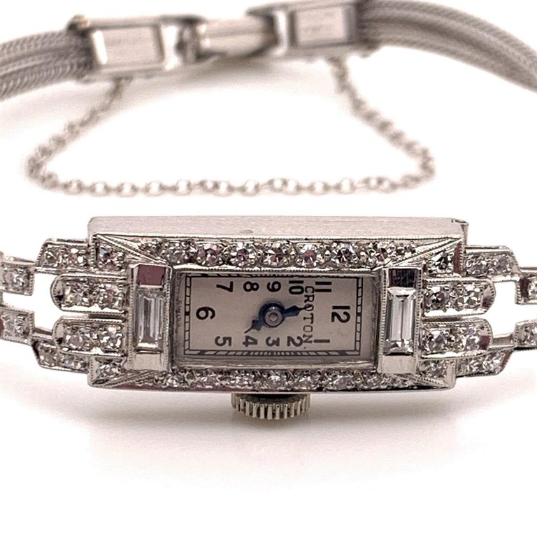 This beautiful vintage timepiece is a showstopper with it's 0.86 carats of diamonds, both baguette and round shaped, set in stunning platinum case with a 14 karat White Gold bracelet and clasp. It is a rare find with its Art Deco step styled design
