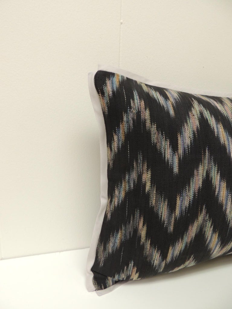 Vintage Ikat woven blue and grey decorative lumbar pillows with black woven linen with grey cotton flat trim.