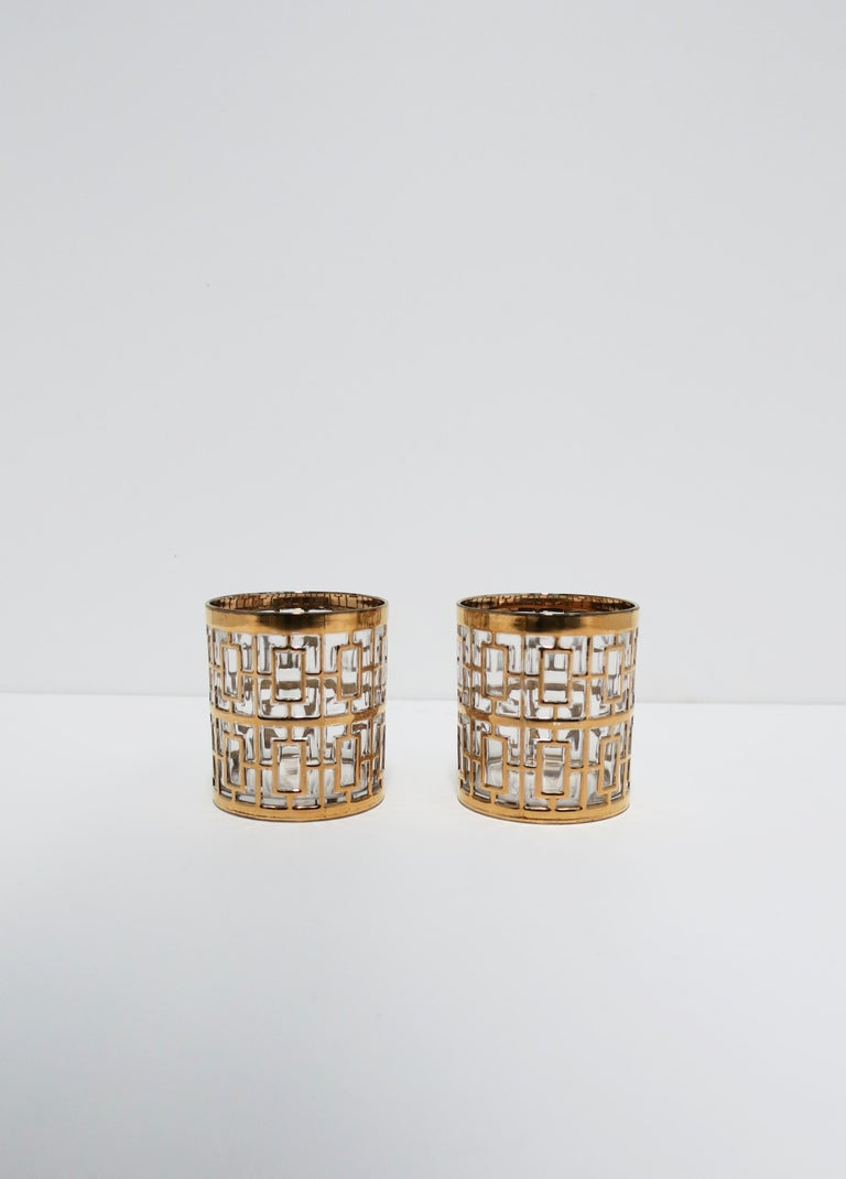 A beautiful vintage set of two (2) cocktail rock's glasses in the Hollywood Regency style by Imperial Glass Co., circa 1960s, USA. Glasses have a 22-karat gold-plate overlay on clear glass in the 'Shoji' screen pattern, which was signature to the