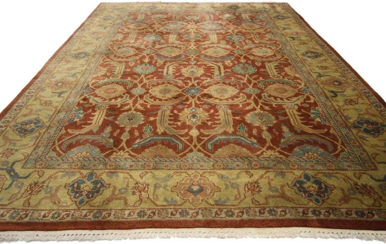 74382, vintage Indian area rug with traditional Persian style. This hand-knotted wool vintage Indian area rug with traditional Persian style features a bold all-over floral lattice pattern of repeating round blossoms surrounded by serrated leaves