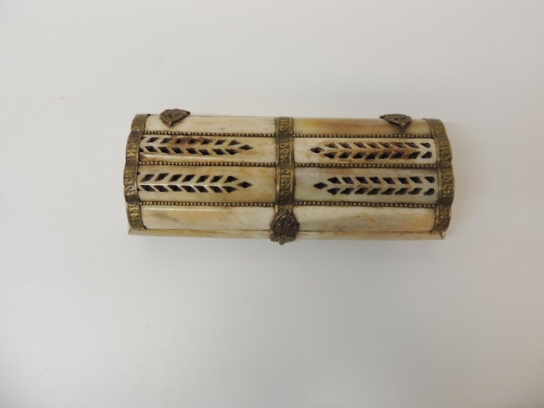 Vintage Indian camel bone jewelry box Rectangular shape with hand hammered brass details. Cover has pierced leaf pattern details and brass beads inset in between the bones. Vintage jewelry box lined with felt. Size: 8