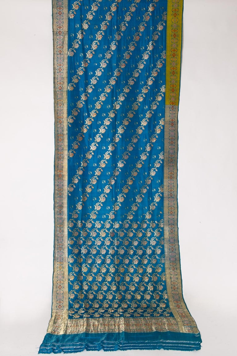 Vintage wonderful turquoise Sari, with a rich floral design: new idea for unusual curtains or an evening dress! It has been worn, but washed. May be still spots. The tissue may be silk, but I think a little synthetic, so I tell