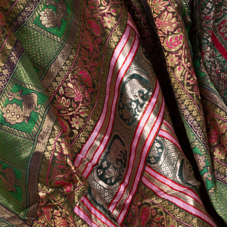 An Indian vintage large silk embroidered fabric from the second half of the 20th century with elephants, peacocks, green, red, pink, silver, fuchsia and golden tones among others. Possibly originating from Rajasthan, this stunning silk fabric is
