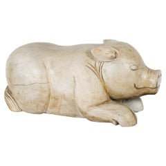 Vintage Indonesian Carved Reclining Pig Sculpture with Weathered Patina