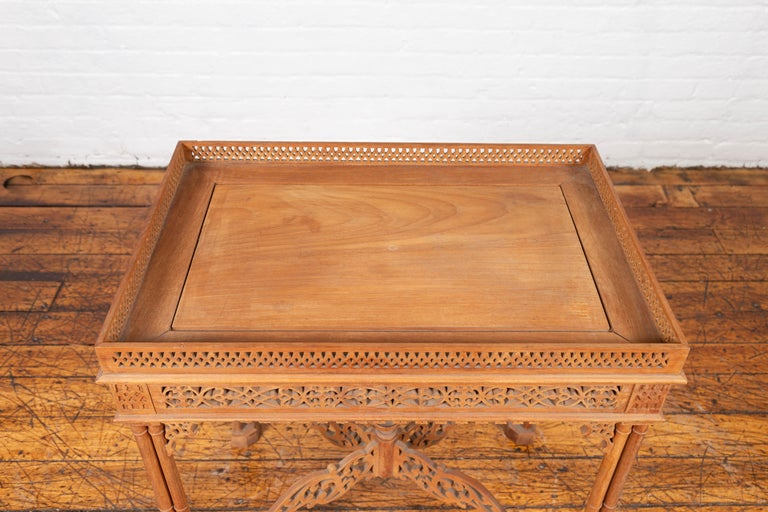 Vintage Indonesian Carved Side Table with Open Fretwork and Cross Stretcher In Good Condition For Sale In Yonkers, NY