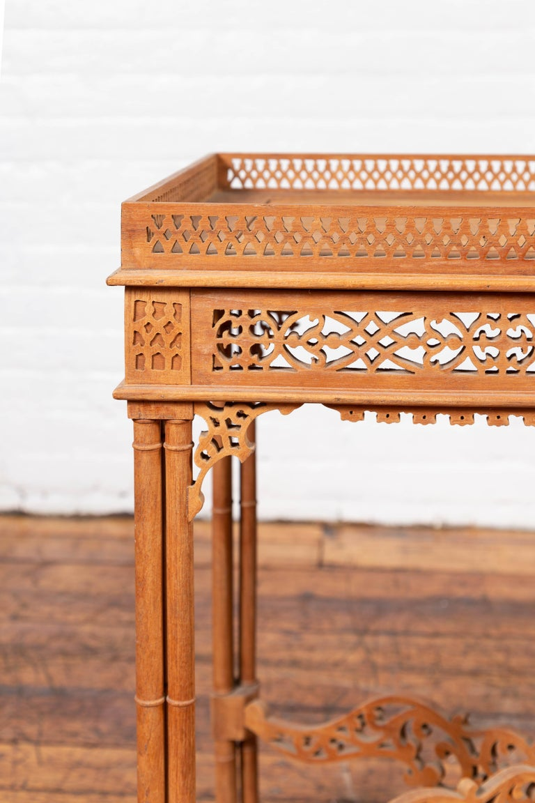 Wood Vintage Indonesian Carved Side Table with Open Fretwork and Cross Stretcher For Sale