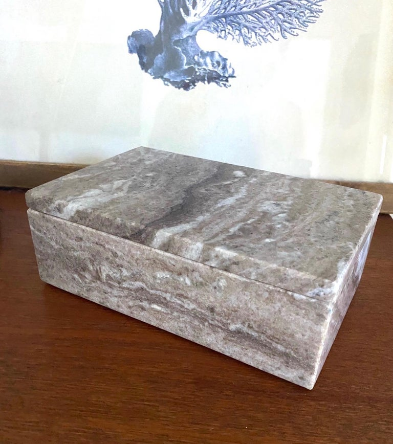 Exotic marble decorative box handmade in Indonesia by local artisans. The box has an Organic Modern design with rectangular form. Fitted lid with a tight close is perfect for storing of small items. The stone box features polished edges with a