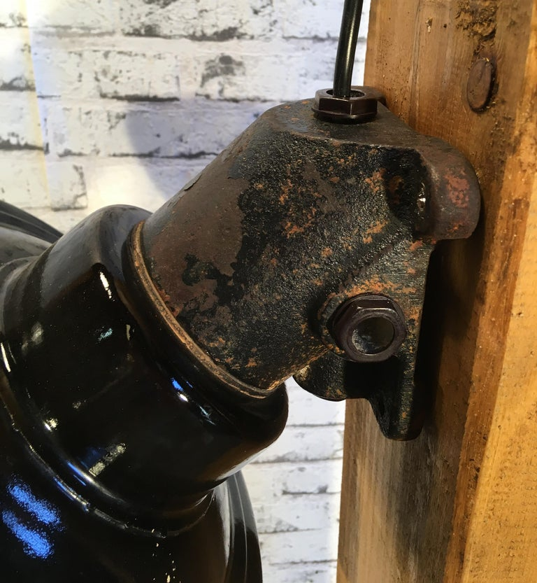 Vintage Industrial Black Enamel And Cast Iron Wall Lamp, 1950s In Good Condition For Sale In Mratin, CZ