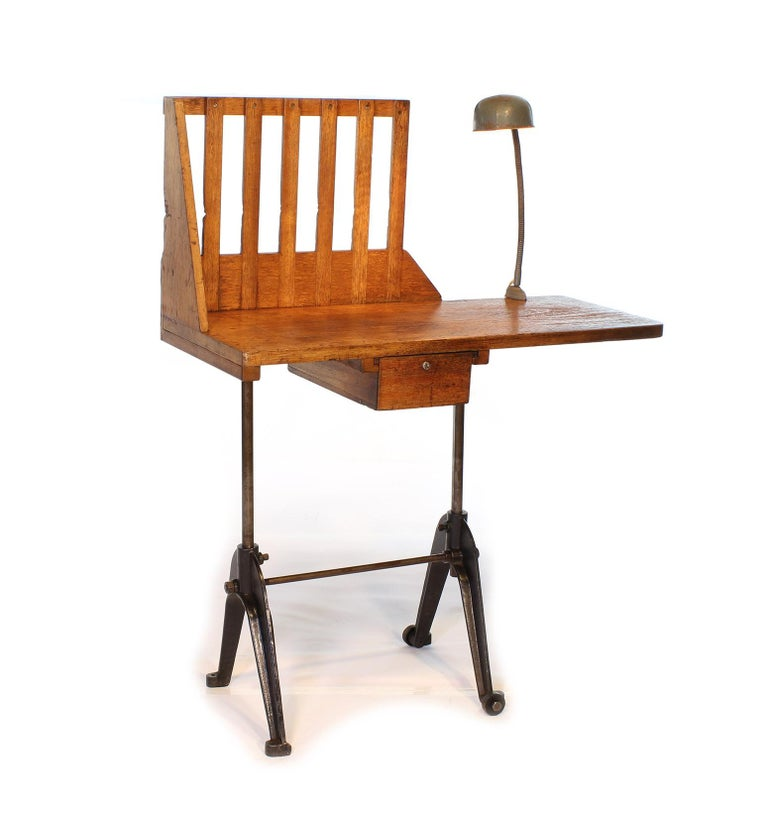 Authentic cast iron and mahogany adjustable entryway table, desk, hall stand. Would also make a great console, telephone or writing table. Features a clamp-on goose-neck desk light, 17