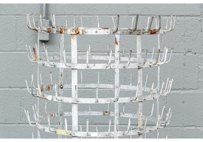 A large and impressive Industrial Era bottle drying rack with great traditional form and an untouched all original patina. An authentic artifact from the great Industrial Age. The patina includes light rust patches and a break in the top band hook