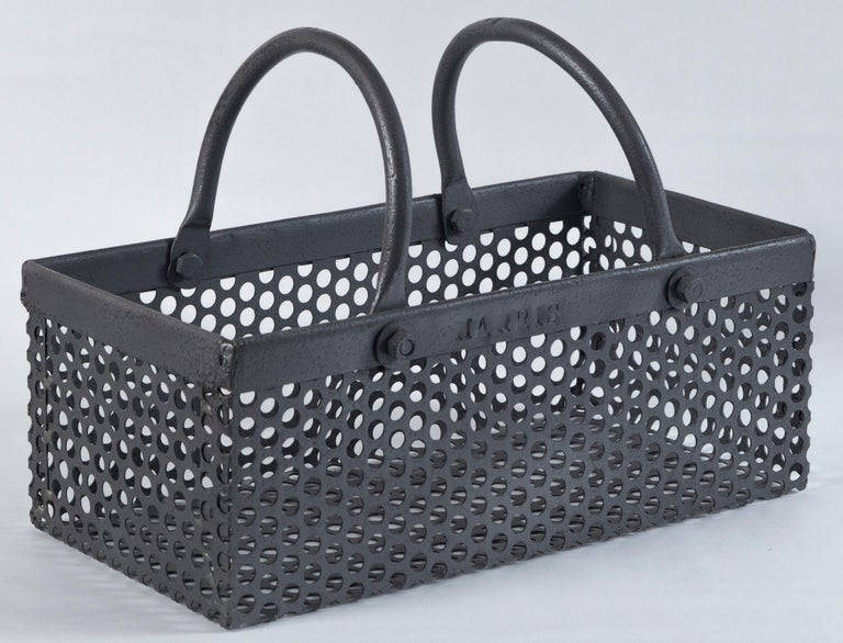 Vintage industrial iron basket, 20th century. Perforated body with two handles. Stamped 'HARRIS'.