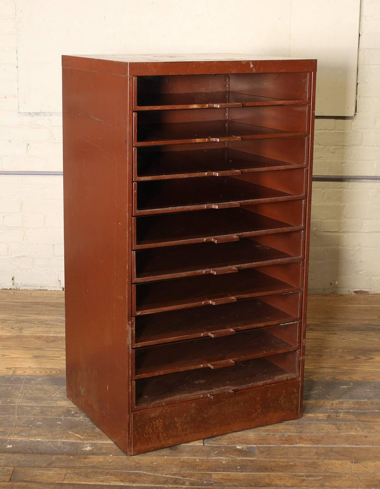Vintage industrial glass front drawer storage apothecary cabinet. Measures: 25