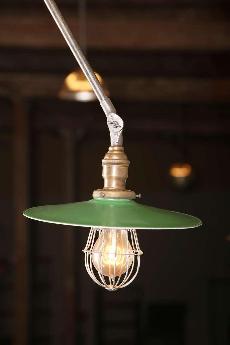 Vintage Industrial, adjustable, O. C. Measures: White ceiling adjustable task light with a 10