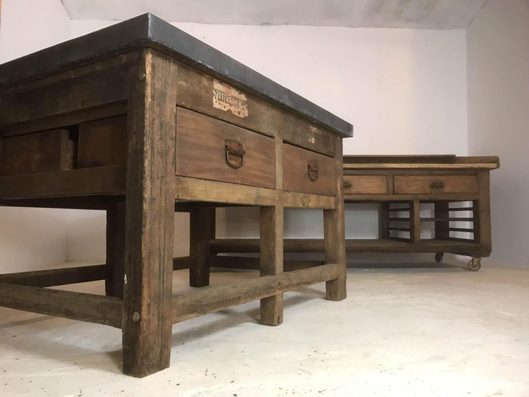 Fantastic mid-19th century double sided pine printers table with hardwood drawers. This piece was a lucky find in an old printers factory in Sheffield; which has laid dormant for years, but is now subject to development. It is an ideal centrepiece