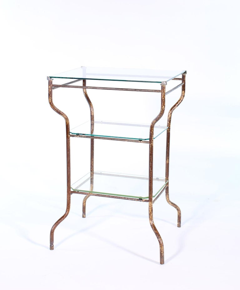 Vintage industrial distressed three-tier metal and glass end table. Measures: 20 1/2