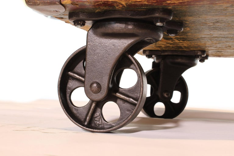 Vintage Industrial Wooden Toy Trunk Coffee Table on Castors For Sale 8