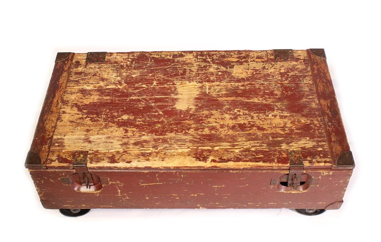 Vintage Industrial Wooden Toy Trunk Coffee Table on Castors In Distressed Condition For Sale In Oakville, CT