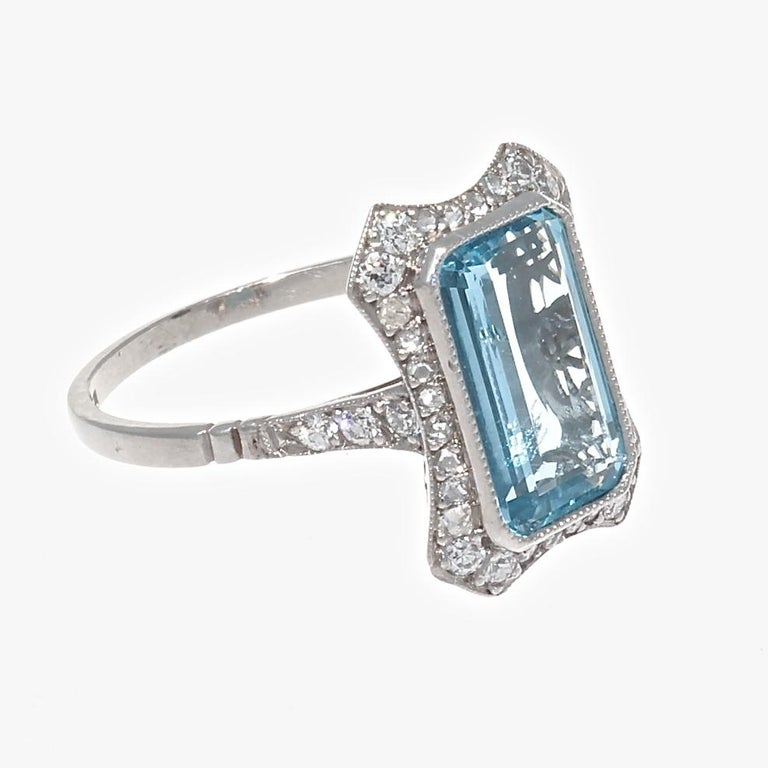 Learning from the past, this modern made ring is a combination of geometric design, style and color. Featuring a 2.10 carat aquamarine surrounded by near colorless diamonds. Hand crafted in platinum. Ring size 7-1/4 and can easily be resized to fit,