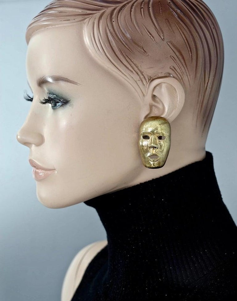 Vintage ISABEL CANOVAS Important Giant Mask Earrings  Measurements: Height: 4.3 cm Width: 2.5 cm  Features: - 100% authentic ISABEL CANOVAS. - Old gold/ Bronze tone. - 3D sculpted mask. - Clip back earrings. - Unsigned piece. - One earring has a