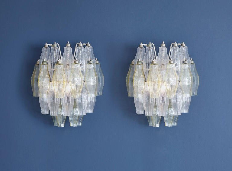 Venini Italy, 1960s  A pair of polyhedral wall lights in clear and citrine blown glass.  Measures: H 40 x W 35 x D 24 cm.
