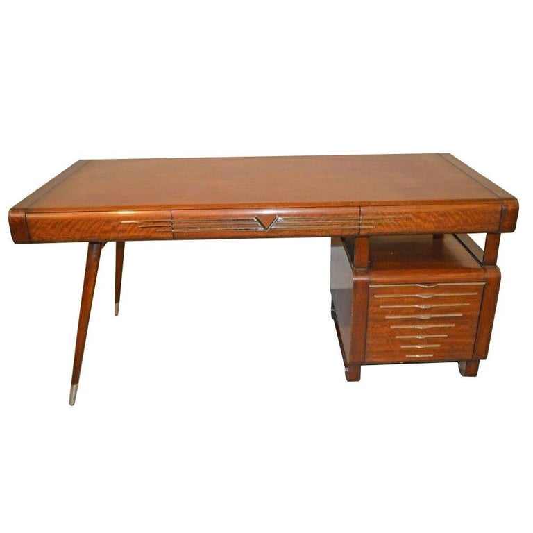 A single pedestal Italian Art Deco style desk with chrome accents in the style of Gio Ponti. This desk features a floating writing with three pull-out drawers and the pedestal has one large filing cabinet. The legs are splayed with chrome caps, and