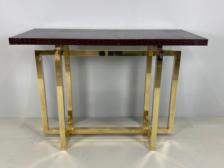Vintage Italian brass console table with crocodile stamped leather top.