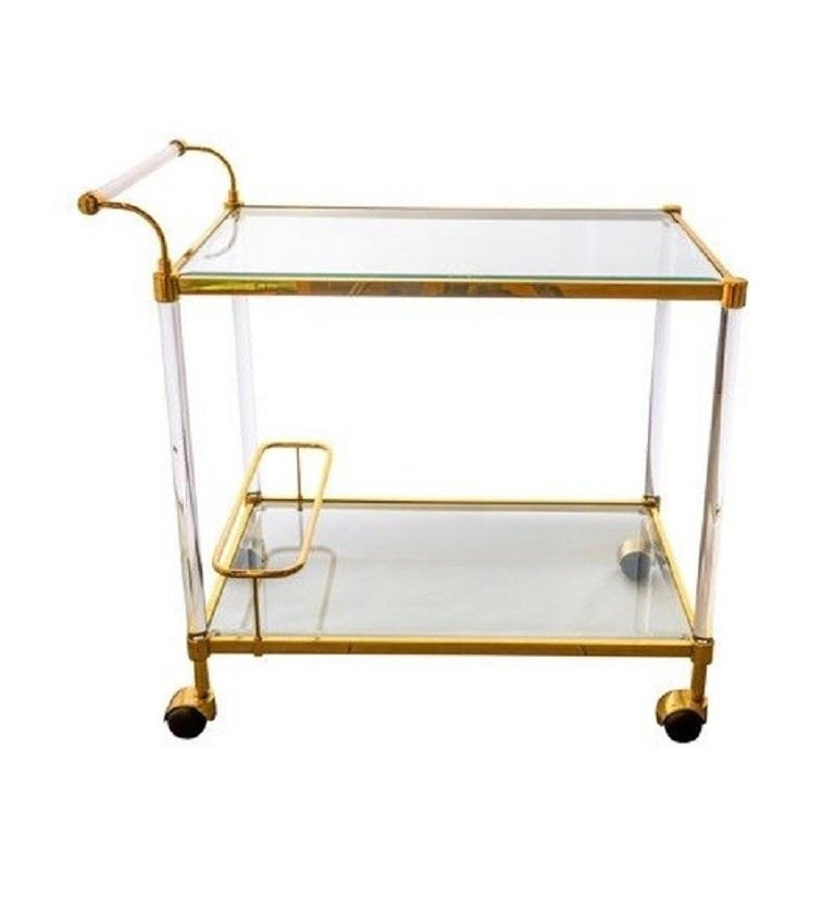 A vintage brass & glass bar cart with two tiers, Italy, circa 1970.