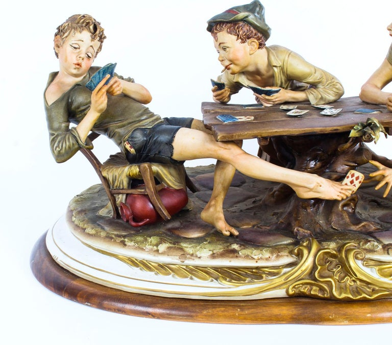 This is a large impressive vintage Italian Capodimonte porcelain figural group sculpture of, 'The Card Cheats' by Bruno Merli, late 20th Century in date.