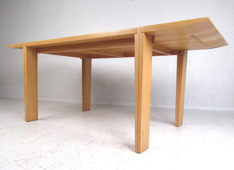 Impressive dining table by Antonio Sibau. Interesting design with unusual dovetailed lap joinery connecting the legs to the tabletop. Great addition to any modern interior. Please confirm item location with dealer (NJ or NY).