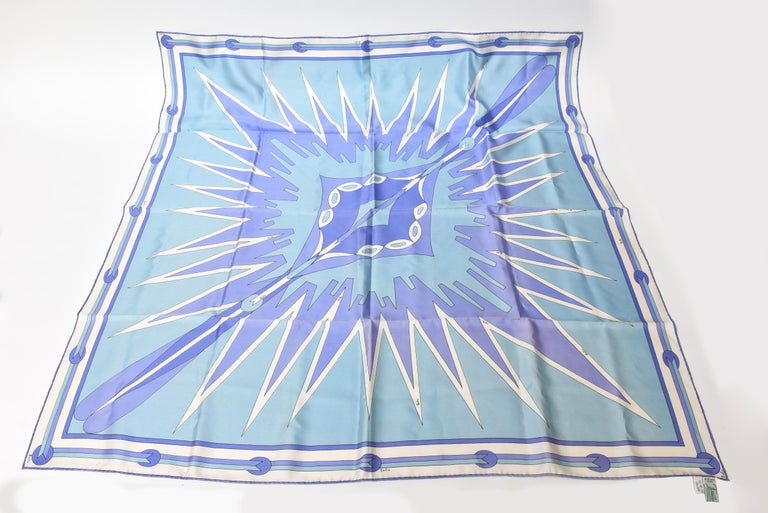 This gorgeous vintage italian silk Emilio Pucci geometric square scarf is so fit for any given season. This is an old tag from the late 60;s or early 70;s. The array of peaceful blue and purple tones is so happy and peaceful yet vibrant. It is 100%