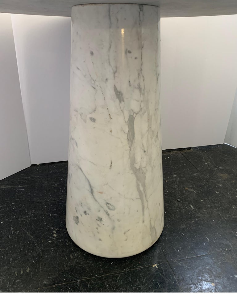 This is chic Italian table of Carrara marble. It's great as a side table or small coffee table.