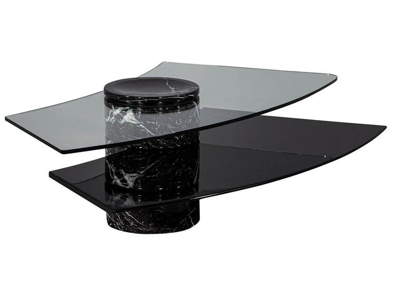 Vintage Italian Mid-Century Modern stone and glass cocktail coffee table. Vintage Italian stone, black lacquer, and glass self-winding cocktail table with two levels.  Price includes complimentary curb side delivery to the continental
