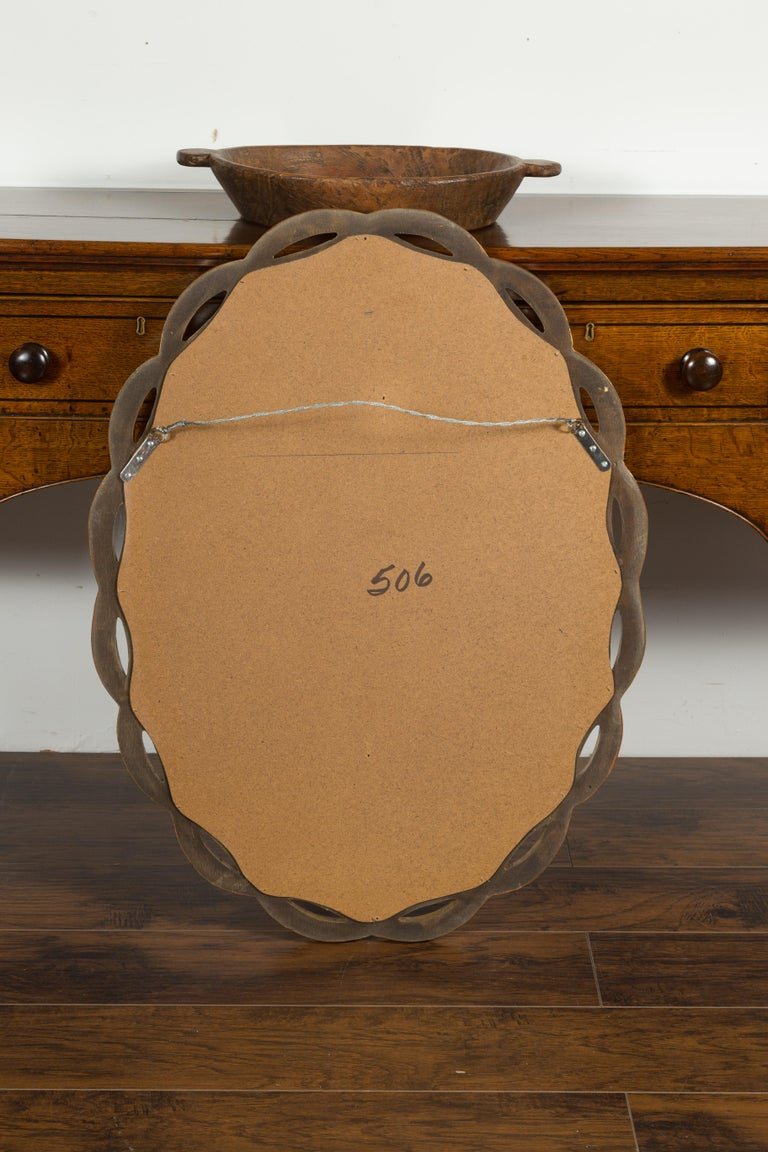 Vintage Italian Midcentury Giltwood Oval Mirror with Intertwining Motifs For Sale 8