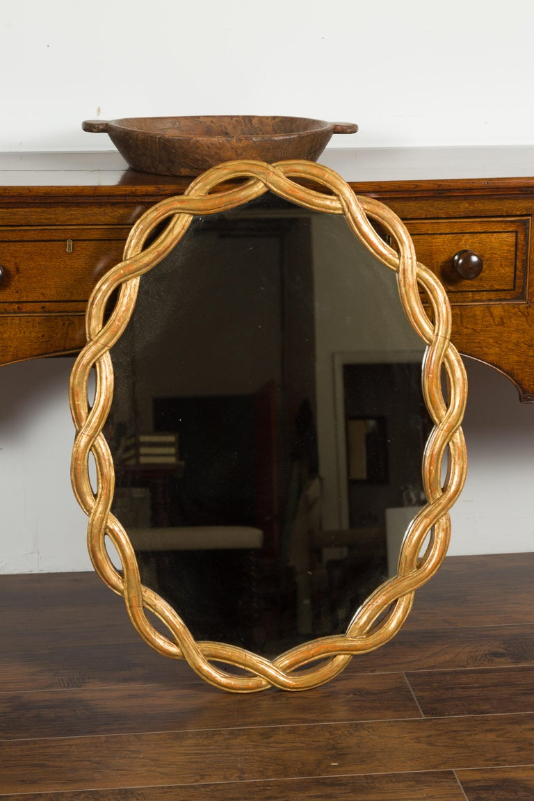 Mid-Century Modern Vintage Italian Midcentury Giltwood Oval Mirror with Intertwining Motifs For Sale