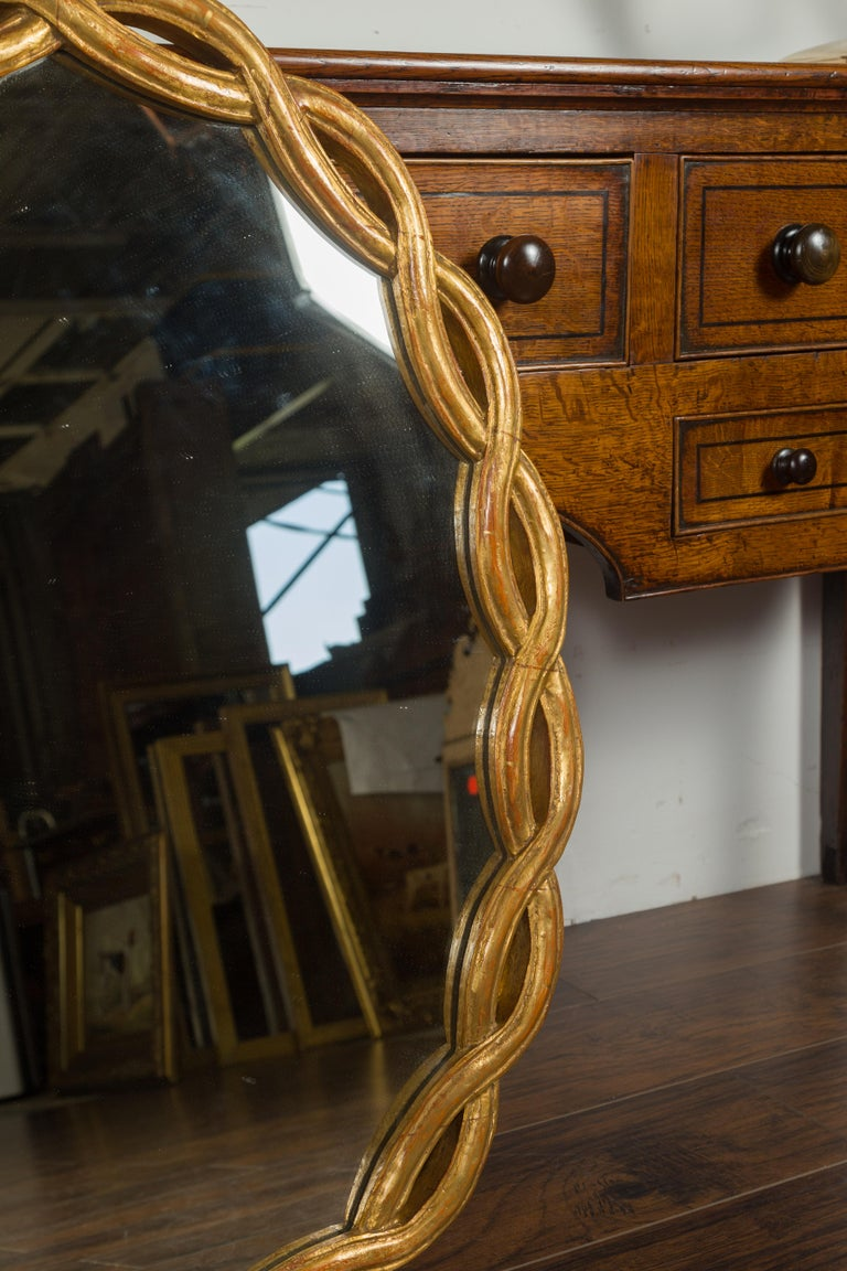 Vintage Italian Midcentury Giltwood Oval Mirror with Intertwining Motifs For Sale 3