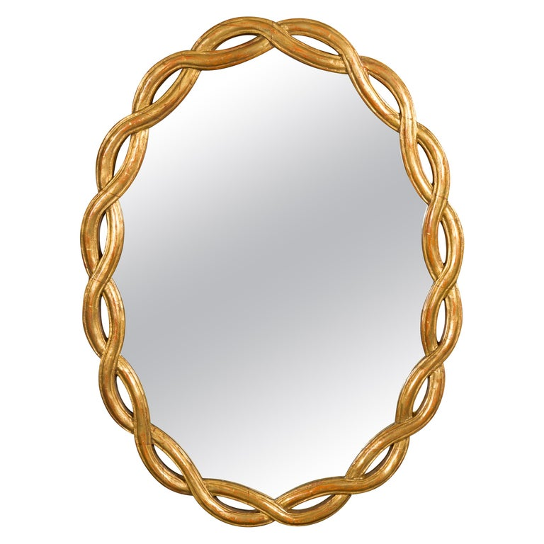 Vintage Italian Midcentury Giltwood Oval Mirror with Intertwining Motifs For Sale