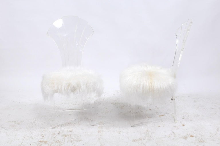 Two Italian vintage Lucite chairs from the mid-20th century with Mongolian fur upholstery and scalloped backs, price and sold individually. These vintage Mid-Century Modern Italian Lucite chairs are as sturdy and comfortable as they are cheeky and