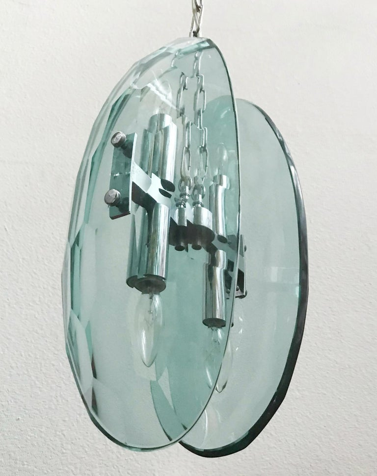 Vintage pendant with two large curved faceted beveled glasses, mounted on chrome frame by Max Ingrand for Fontana Arte/ Made in Italy, circa 1960s