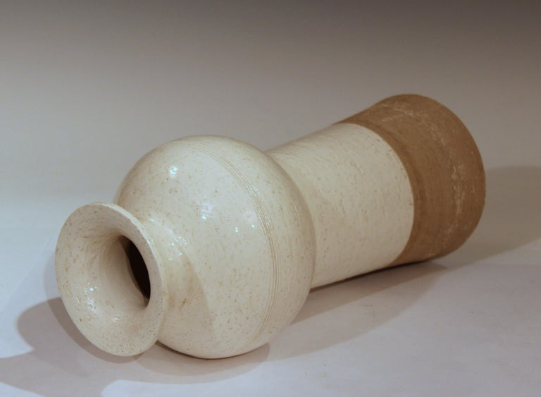 """Vintage hand-turned Italian pottery for Raymor off white vase, circa 1960s. 12 1/2"""" high, 6"""" diameter. Excellent condition, small flake at rim, touch ups at footrim, as shown."""
