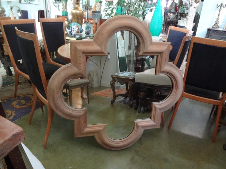Stunning large Italian quatrefoil mirror of solid oak. This beautifully carved well-made oak mirror dates to the 1970s and is in great condition. This vintage Italian mirror could be gilded, cerused, lacquered or painted if desired. Fabulous as is.