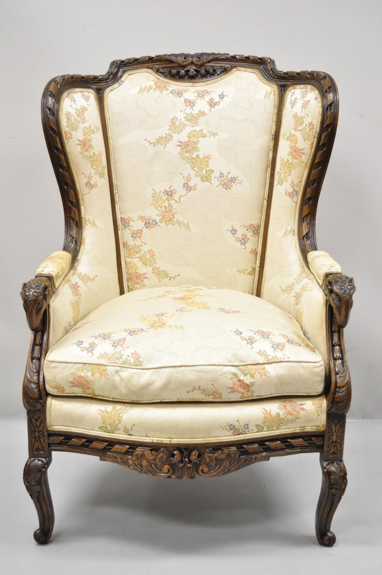 Vintage Italian Regency style rams head carved walnut wingback bergere arm chair. Item features ram's head carved armrests, solid wood frame, upholstered armrests, finely carved details, cabriole legs, very nice vintage item, great style and form.