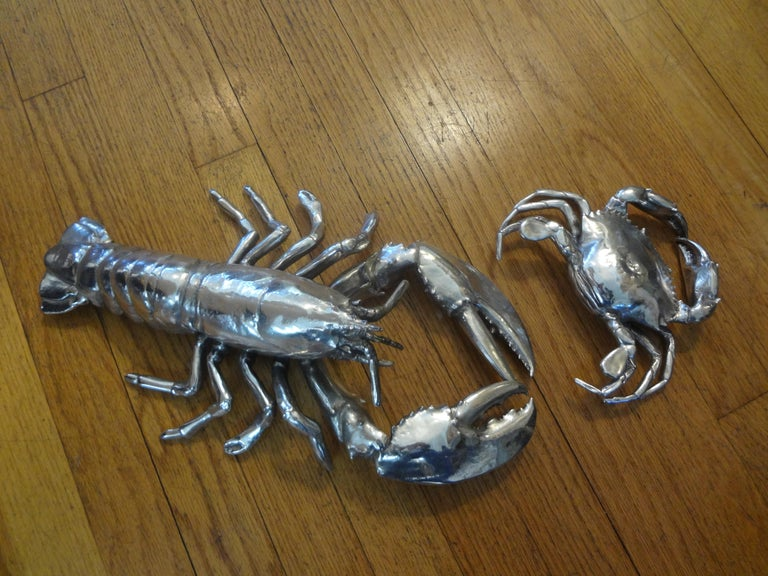 Vintage Italian silver plated lobster and crab. Our vintage silver plated pair of sea creatures includes a lobster and a crab. These interesting silver plated sculptures make unusual decorative accessories. These are very similar to those created by