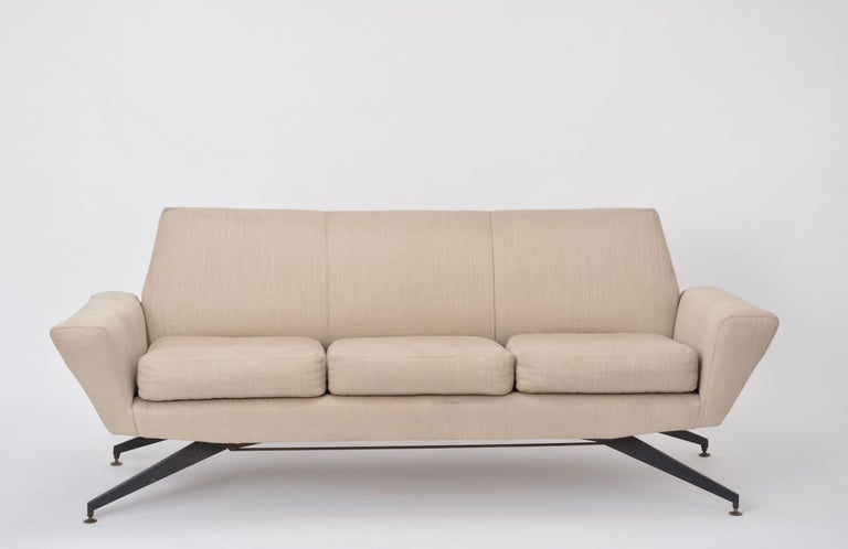 Italian Mid-Century Modern sofa with black Metal base by Lenzi  This three-seat sofa was produced by Italian company Lenzi in the 1950s. The base is made of lacquered metal. The upholstery is in good condition, the fabric with signs of use and some