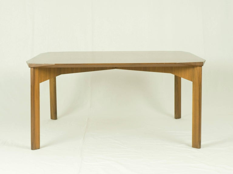 Teak wood coffee table with faceted corners and shaped legs. Perfect condition.