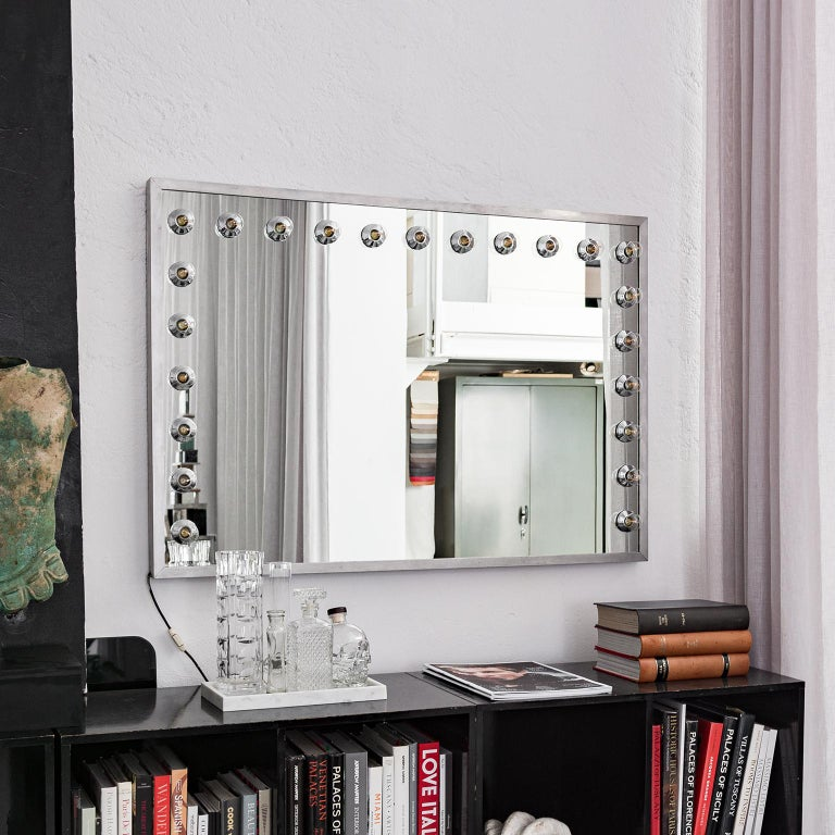 Offered here is a vintage Italian vanity mirror, most likely from the 1970s, equipped with 23 lights mounted on three edges of the mirror. It is very large and preserved in very good conditions. It is a very cool and original complement for any kind