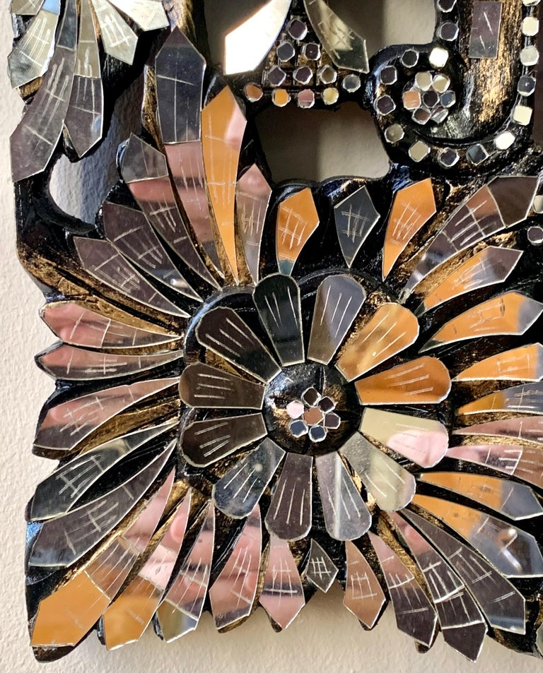 Exquisite Venetian style mirror features a border of flowers made up of layers and layers of mirrored glass. So much prettier in person.